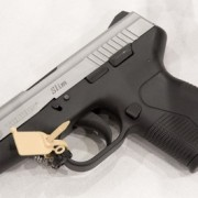 2008shotshow-day3-taurus-pt709ss-1-tm.jpg