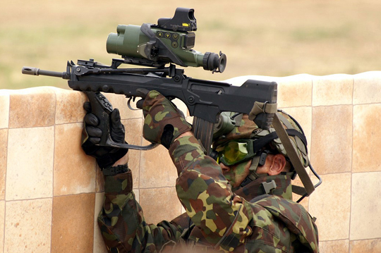 Felin equipped FAMAS rifle in action. Works just as well in the dark.