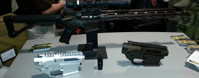 Shown here is their 3-gun model, two of their lowers, and a muzzle brake.