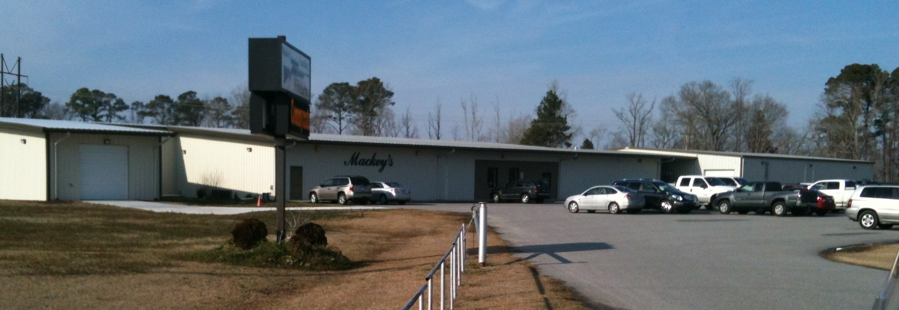 The entrance to Mackey's and the parking lot. Very unassuming, one would think it's just another commercial warehouse on the side of the highway