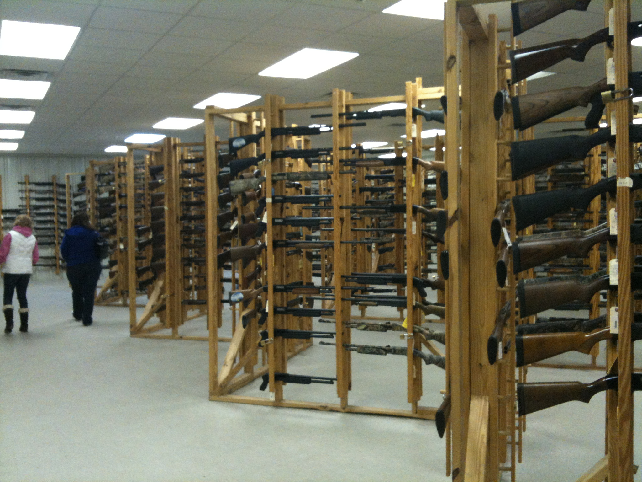The modern day sporting shotgun section. These are mostly pump action and semi automatic shotguns. The single shot, doubles and Over and Unders are by the handgun display cases. Notice how the racks display as much of the firearm as possible and making it accessible to the customer but are also quite secure.