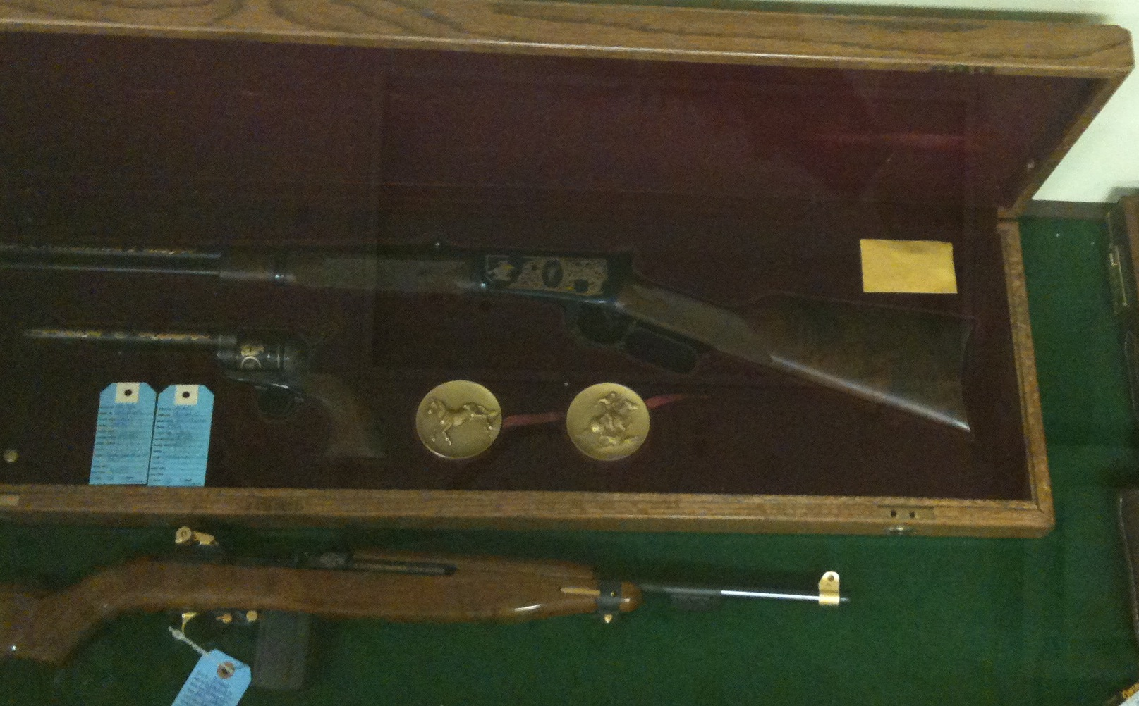 The extremely rare and high quality firearms are kept under lock and key in the glass display cases that the handguns are in.