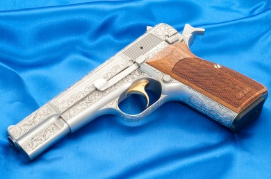 """Ken's favorite """"collector"""" pistol is his Browning Hi-Power Renaissance made in 1972, which is fully hand-engraved, and wears Nill wood grips."""