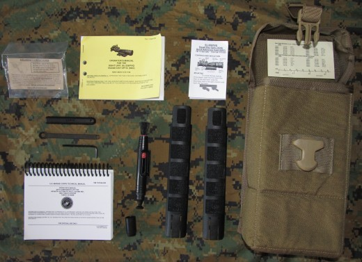 Trijicon SDO gear pouch with accessories. The gear bag is manufactured by Eagle Industries and is issued with every M27. Marine Corps T M 11758A-OR for the SDO/RMR and TM11810A-OR for the M27 are displayed top and bottom respectfully. M27 wrench is shown disassembled to left of SDO Lens Pen. Left of bag are H&K rail protectors. Extra pamphlets are data tables, SDO care guides and LaRue Tactical throw mount lever care information.