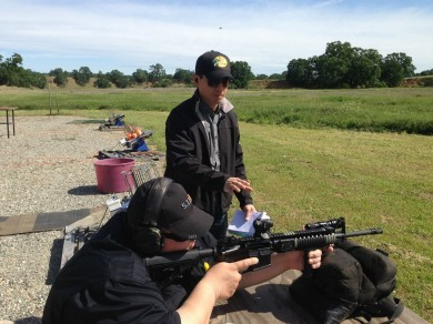 The author explaining the proper rifle bench rest shooting technique, while a fellow instructor-candidate demonstrates to the class.