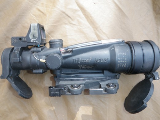 SDO and RMR mounted on top. Adjustment dials for elevation and windage are the two screw caps in front of RMR. Dust covers may positioned at any angle that the gunner is comfortable with. Also note tape over the Fiber Optic light collector to maintain a more crisp sight picture. Dust covers may be readily positioned at any angle to the SDO for ease of operation.