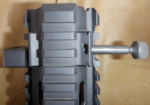 FFRS captive locking screw extended out. Sling mount is on left side and can be moved anywhere on the rails. Note the close proximity of screw block to rails, preventing some attachments to the rail.