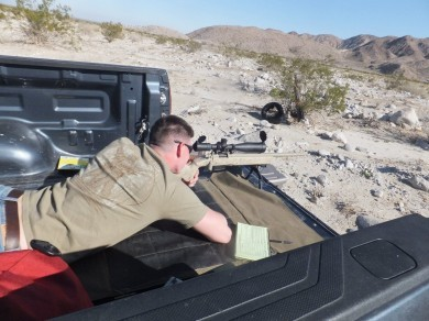 "A QShooter takes aim during a ""Precision Rifle Camp"" event on BLM land near Ocotillo Wells, CA."