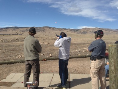 A Quick Left shooter takes aim at a flying clay using a Benelli M2 shotgun.