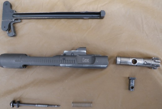 Bolt carrier group and charging handle disassembled. This is relatively the same condition of parts after extended firing. Charging handle will function in M16A4.