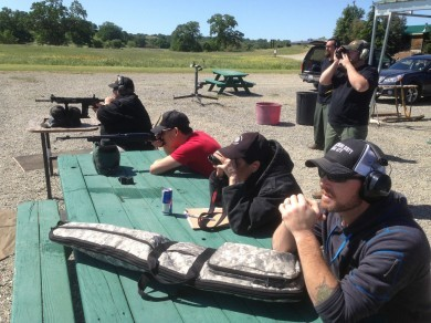 Another instructor candidate and I shooting our rifle qualification course of fire. The lead instructor and other candidates look on.