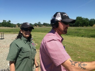 Denise King of Defensive Accuracy works with an NRA Instructor-candidate on the range.