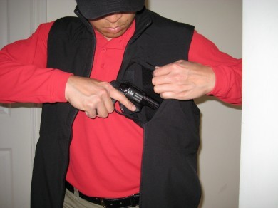 A Ruger LCR fits nicely in the chest pocket. The LCR was in this pocket for all the above pictures.