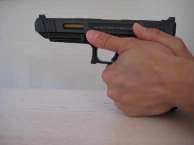 Support hand is more toward the rear of the pistol.