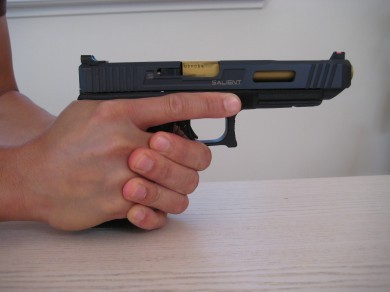 All the support hand fingers are wrapped around the shooting hand.