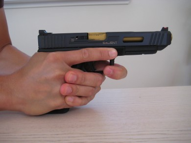 The support hand index finger pulls toward the left side of the pistol.