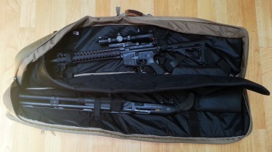 Two long guns fit in the main compartment.