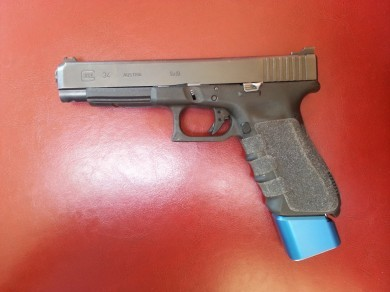 The large Taran Tactical base pad inserted into a Glock 34.
