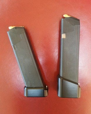 On the left is a 10 round Glock 17/34 magazine with a small Taran Tactical base pad. On the right is a 17 round Glock 17/34 magazine with a large Taran Tactical base pad.