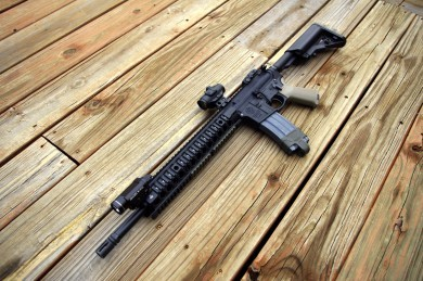 Smith and Wesson M&P 15...rebuilt with Colt internal parts. Lucid M7 Micro Dot. Streamlight TLR1S mounted on a  Haley Strategic Thorntail Offset light mount. Excellent rifle.