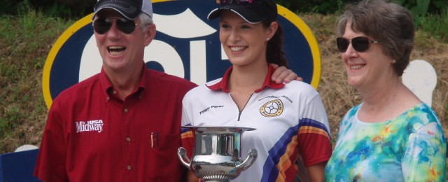 Tiffany Piper accepting the 2013 Bianchi Cup Junior National Championship title. At left, MidwayUSA Founder and CEO Larry Potterfield.