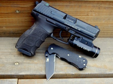 The Heckler and Koch P30 has a MIL-STD 1913 rail for mounting lights and accessories. Mounted is a Streamlight TLR-1S.