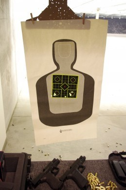 5 shot groups at 7 yards. The guns are capable of a lot better accuracy! The Heckler and Koch group is on the left. The Glock group is on the right.