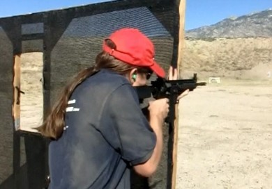 Shootings the Colt 901 at a competition skills class