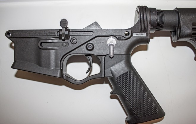 Left side of lower receiver, clearly shows the anti-walk system created by ATI.