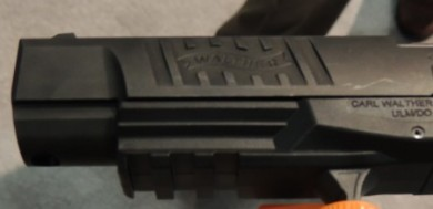 The left front slide serration has the Walther emblem engraved inside.