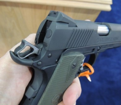 A closer look at the Commander style hammer, beavertail grip safety, and dovetail rear sight on the 1911 Poly.