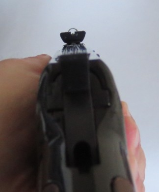 The sight picture of the Henry. Note the hood on the front sight.