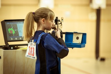Olympic shooting takes a tremendous amount of training and discipline. Tia focuses her mind and breathing before re-engaging her target. Photo by Matthew Kou, Imagineering Studios Inc.