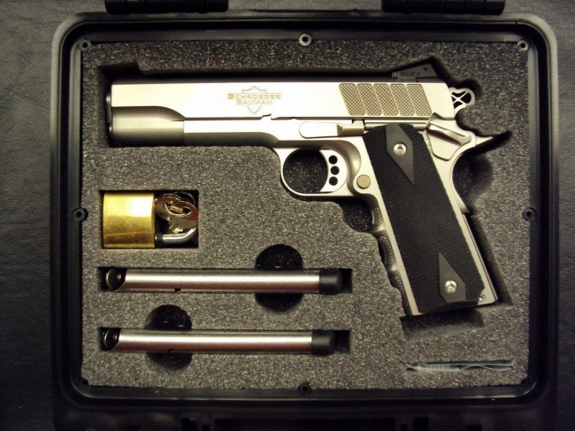 A stock-photo of the American Defender (full-size) with finger groves w/ optional carrying case.