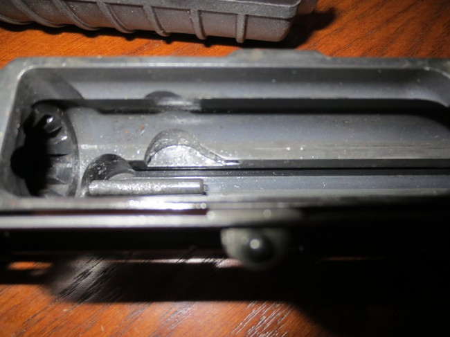 The upper receiver. Note the slot now carved by the cam pin at the rear of the cam pin rotation area.