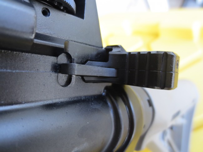 From this angle, you can see the hood as it extends above the rail on the receiver.