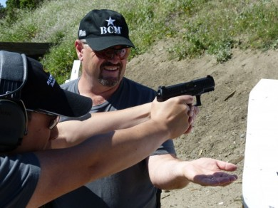 A student intently focuses on trigger control, dry firing while balancing a penny on his front sight.