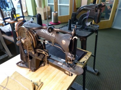 Old world technology still has a central place in a lot of businesses. TAD uses this seasoned Singer sewing machine on a lot of their designs.