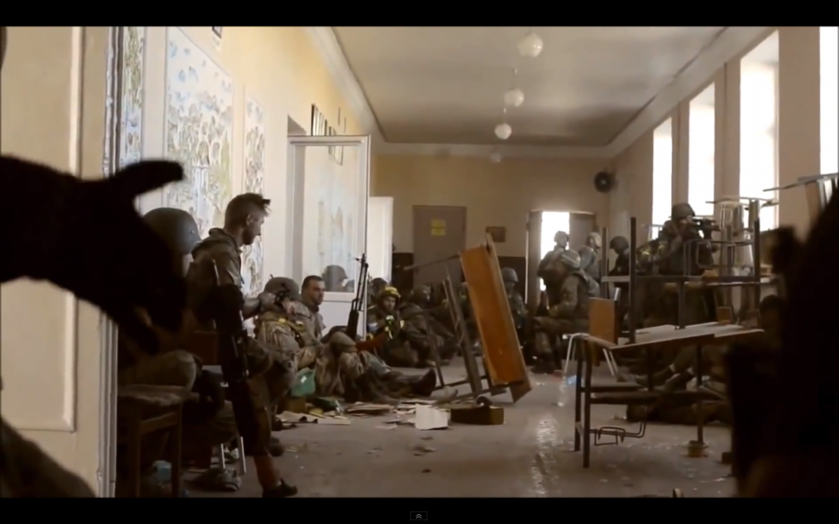 Notice the sniper with SVD peering through the window at right. Also throughout the video, soldiers are taking a break on the floor while others are returning fire at the same time.