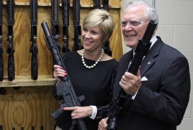 Georgia Governor Nathan Deal and Daniel Defense EVP Cindy Daniel pose for pictures with an
