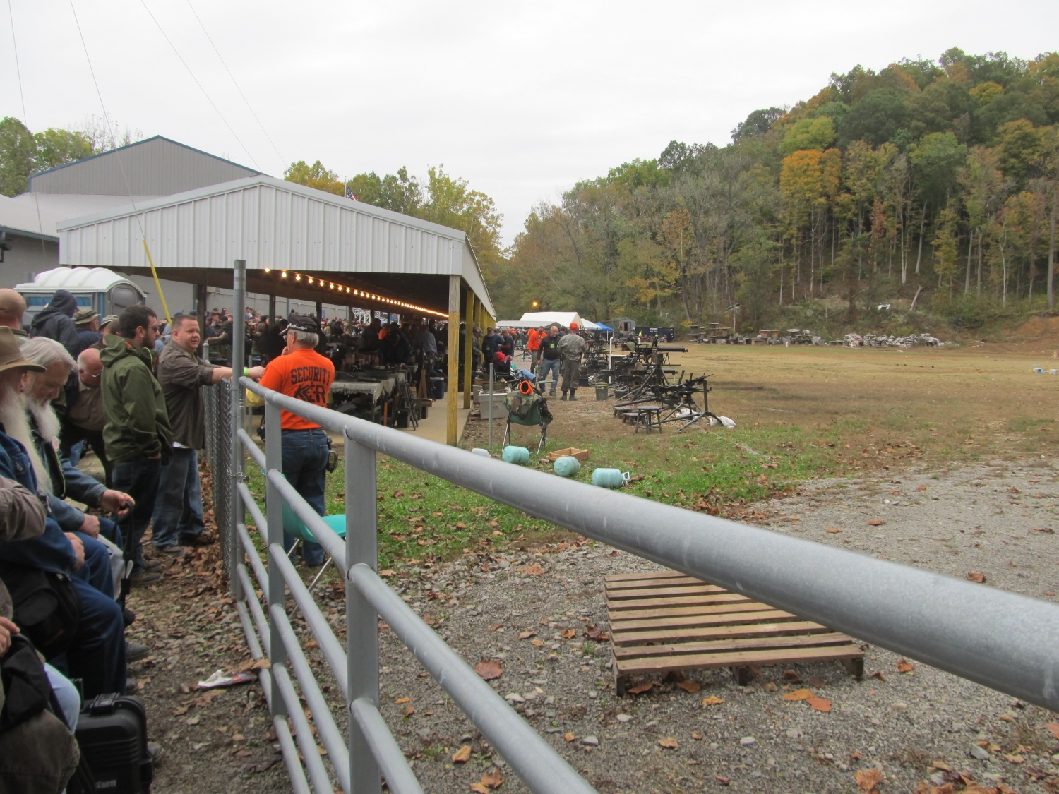 A view looking down the Main Line from the right side. Notice the gate  separating bystanders from the shooters. The men in bright orange shirts are Knob Creek employees.