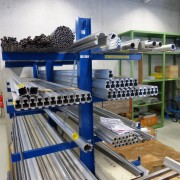 Stocks of pre-fabricated aluminum and steel, ready to be cut into receivers and silencer bodies