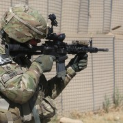 U.S._Army_Staff_Sgt._Chad_Hart,_an_adviser_with_the_10th_Mountain_Division,_fires_his_M4_carbine_downrange_at_Khair_Kot_Garrison,_Paktika_province,_Afghanistan,_June_6,_2013_130606-A-NQ567-063