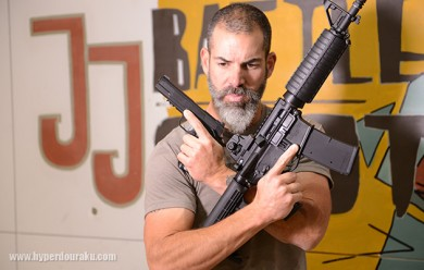 Costa posing with a 1911 and an AR-15. Again, most likely airsoft. Photo: www.hyperdouraku.com
