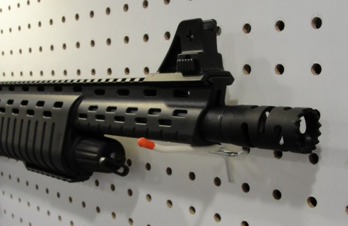 The A2 style detachable front sight, and choke style muzzle device.