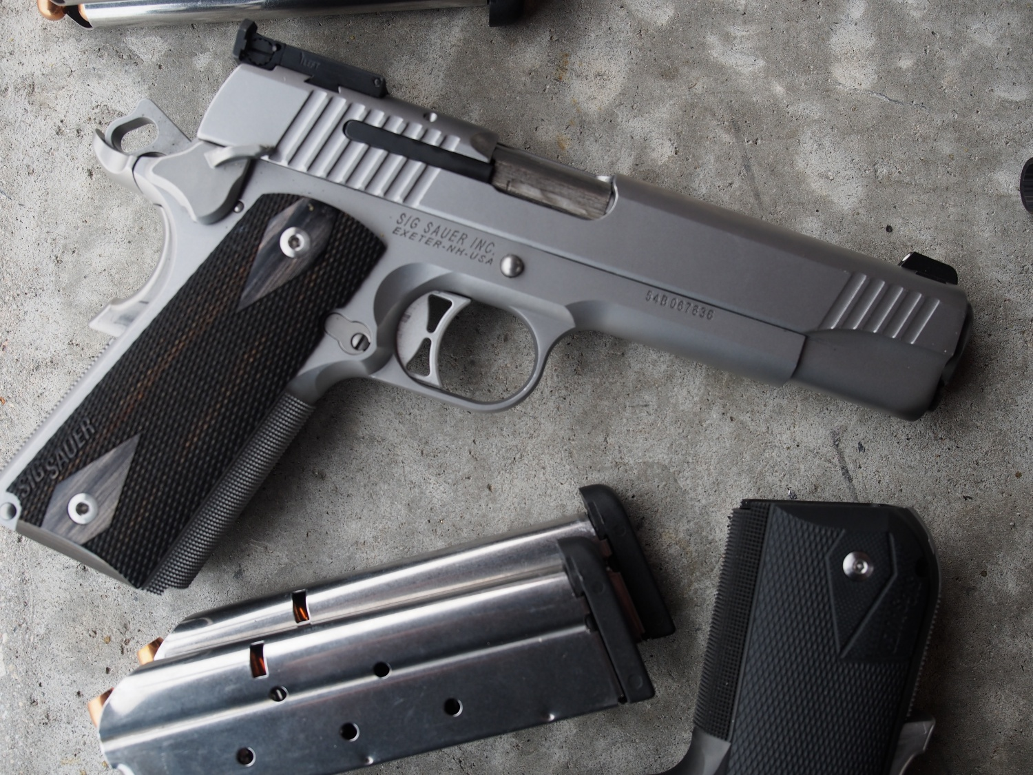 SIG Traditional 38 Super in stainless steel with adjustable sights.