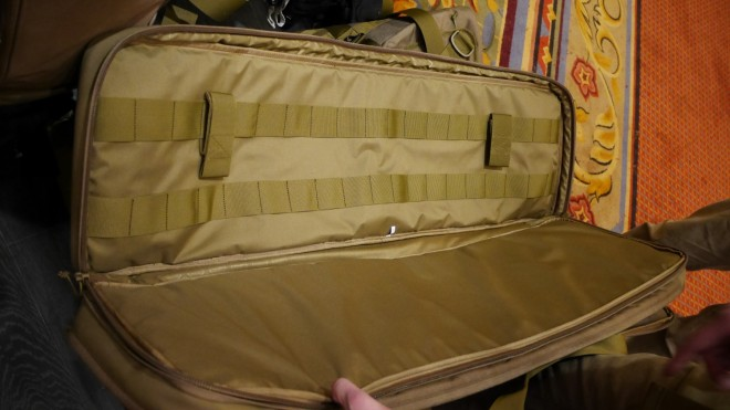 The brand new Hazard4 double rifle case with a slick nylon lined interior on one side of the case.