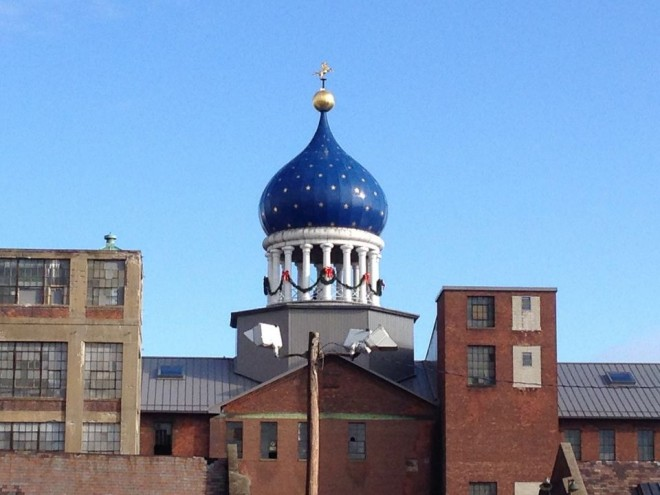 In this Dec. 17, 2014 photo, a blue onion-shaped dome sits atop Samuel Colt's 19th century gun factory in Hartford, Conn., and is perhaps the best known symbol of a bygone era. As the decade-long push to make a national park out of the now-closed gun factory won approval in Washington, elected officials hailed the project as a way to boost one of Hartford's poorest neighborhoods and honor the revolver as a marvel of manufacturing. Notably absent was Colt's Manufacturing Co. _ the company that, somewhat uncomfortably, remains based today in a state still reeling from the Newtown shootings and now sporting some of the nation's strictest gun laws. (AP Photo/Michael Melia) Caption from AP