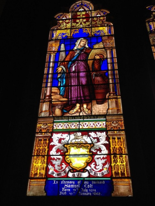 In this Dec. 17, 2014 photo, a stained glass window depicting Samuel Colt is seen inside the Church of the Good Shepherd, which was built by the widow of Samuel Colt, in Hartford, Conn. As the decade-long push to make a national park out of Colt's now-closed gun factory and other buildings in Coltsville won approval in Washington, elected officials hailed the project as a way to boost one of Hartford's poorest neighborhoods and honor the revolver as a marvel of manufacturing. Notably absent was Colt's Manufacturing Co. _ the company that, somewhat uncomfortably, remains based today in a state still reeling from the Newtown shootings and now sporting some of the nation's strictest gun laws. (AP Photo/Michael Melia) Caption from AP.