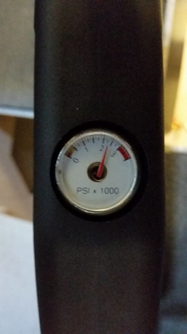 The pressure gauge on the bottom of the air rifle.